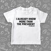 "Funny toddler shirt with the caption ""I Already Know More Than The President"" in white."