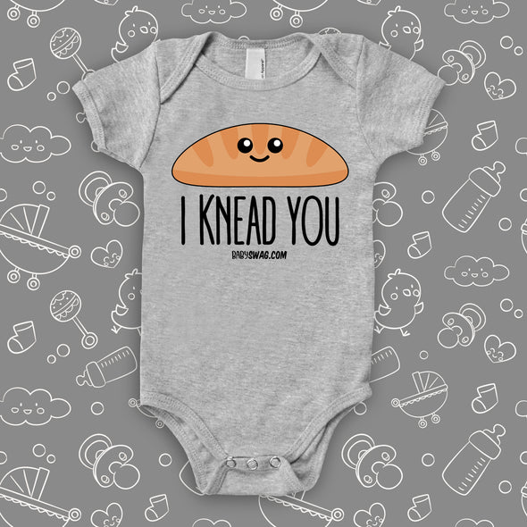 "Funny infant onesie saying ""I knead you"", color grey."