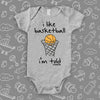 "Cute baby boy onesies with saying ""I Like Basketball, I'm Told"" in grey."