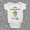 "Cute baby boy onesies with saying ""I Like Basketball, I'm Told"" in white."