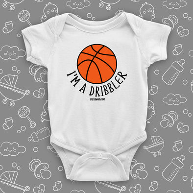 "Baby boy onesies with saying ""I'm A Dribbler"" in white."