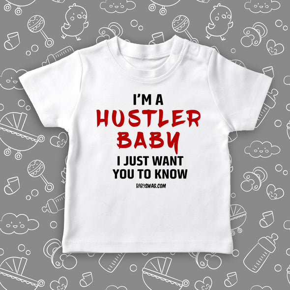 "Toddler girl shirts with saying ""I'm A Hustler Baby"" in white."