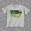 "A funny toddler shirt saying ""I'm Kind Of A Big Dill"", with the image of a pickle wearing sunglasses, in grey."