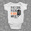 "Hilarious baby onesies with saying ""I'm Not Crying, I'm Doing My Singing Warm Ups"" in white."