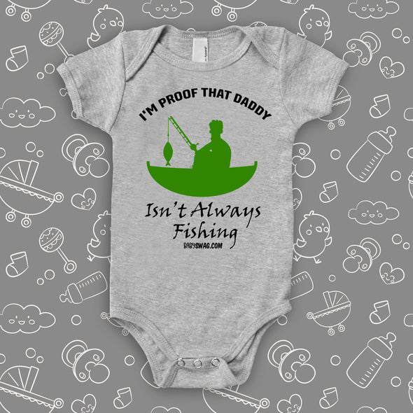"Hilarious baby onesies with a saying ""I'm Proof That Daddy Isn't Always Fishing"" in grey and the drawing of a man in a fishing boat included."