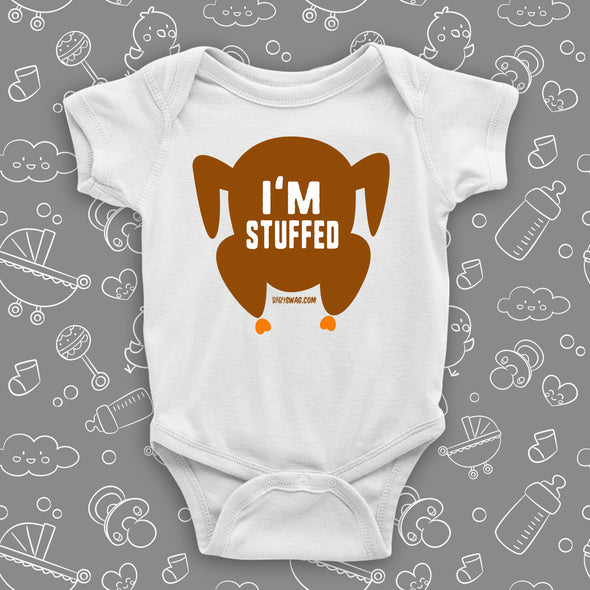 "Hilarious baby onesies with saying ""I'm Stuffed"" and an image of roasted turkey in white."