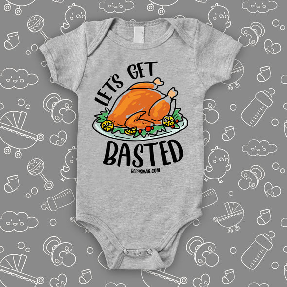"Funny baby onesies with saying ""Let's Get Basted"" in grey."