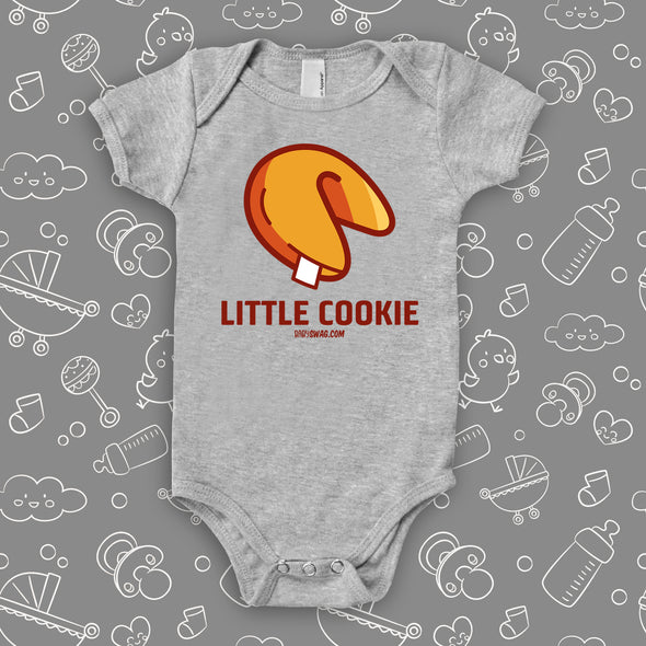 "A grey cute baby onesie with ""Little Cookie"" print and an image of a fortune cookie."