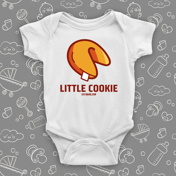 "A white cute baby onesie with ""Little Cookie"" print and an image of a fortune cookie."