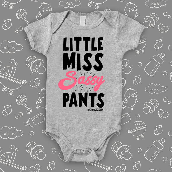 Cute baby girl onesie with a saying ''Little Miss Sassy Pants'' in grey.