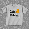 The ''Little Nugget'' toddler graphic tees in grey.