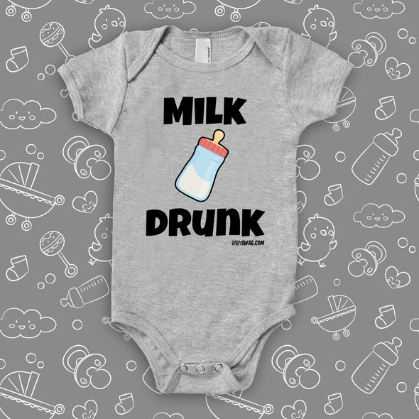 "Grey hilarious baby onesie with ""Milk drunk"" saying and an image of a baby bottle."