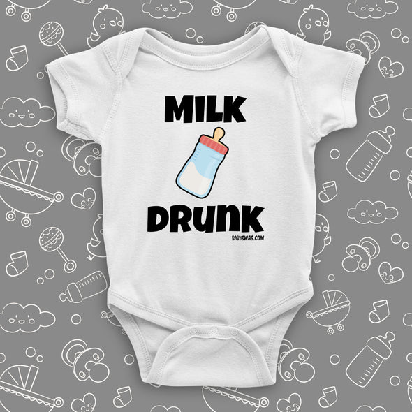 "White, hilarious baby onesie with ""Milk drunk"" saying and an image of a baby bottle."