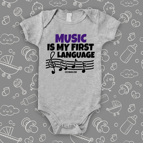 "Cute baby onesies with saying ""Music Is My First Language"" in grey."