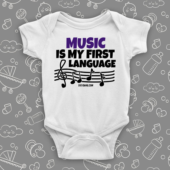 "Cute baby onesies with saying ""Music Is My First Language"" in white."
