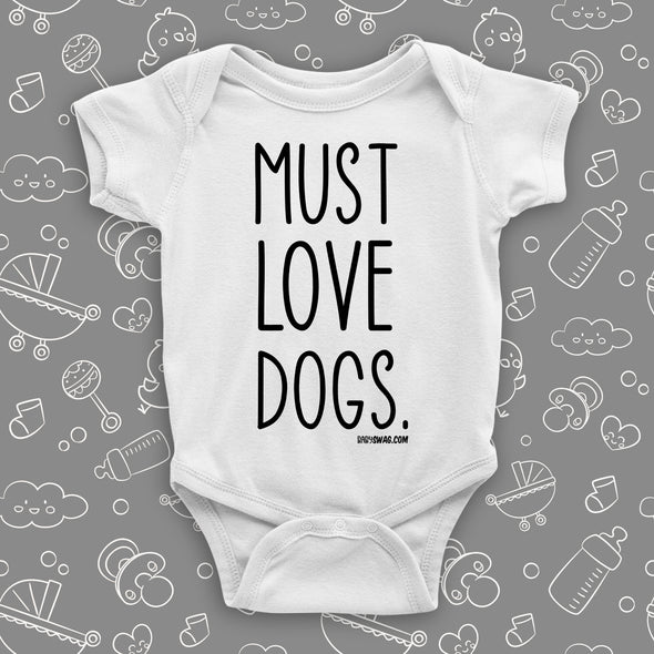 "White cool baby onesie with print ""Must love dogs."""