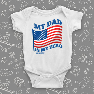 "White cool baby onesie saying ""My dad is my hero"" with an image of the American flag."