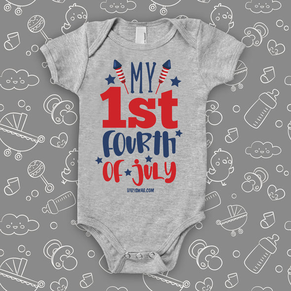 "Graphic baby onesies with saying ""My First 4th of July"" in grey."