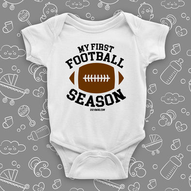 "The ""My First Football Season"" cute baby boy onesies in white."