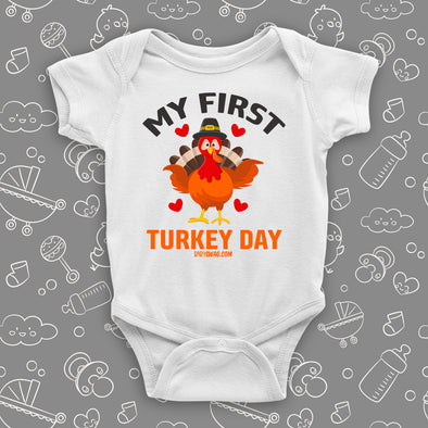 "Cute baby onesies with saying ""My First Turkey Day"" and an image of a turkey in white."