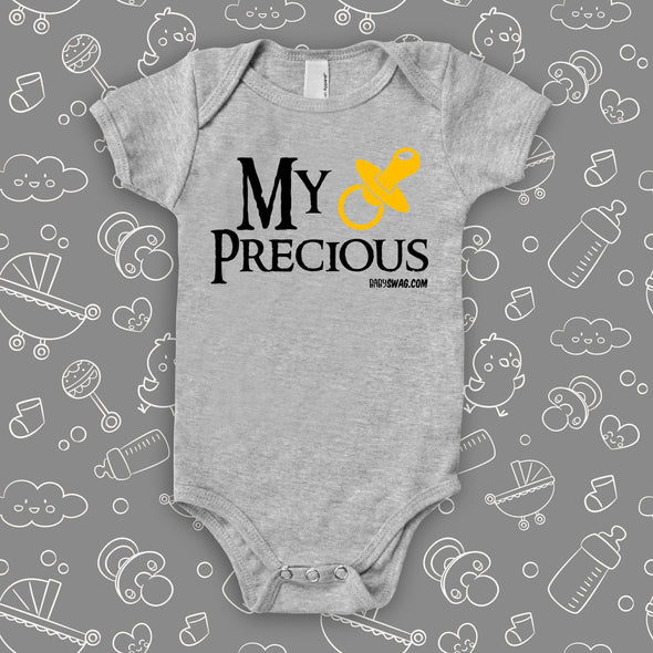 "The ""My Precious"" baby onesies in grey."