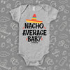 "Cool baby onesie saying ""Nacho Average Baby"" with an image of a hat, color grey."