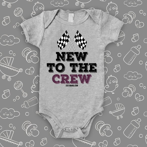 "A grey baby boy onesie with ""New To The Crew"" print."
