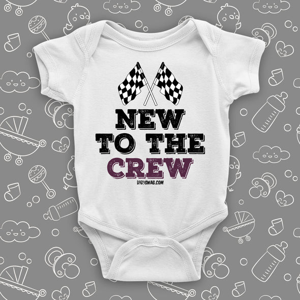 "A white baby boy onesie with ""New To The Crew"" print."