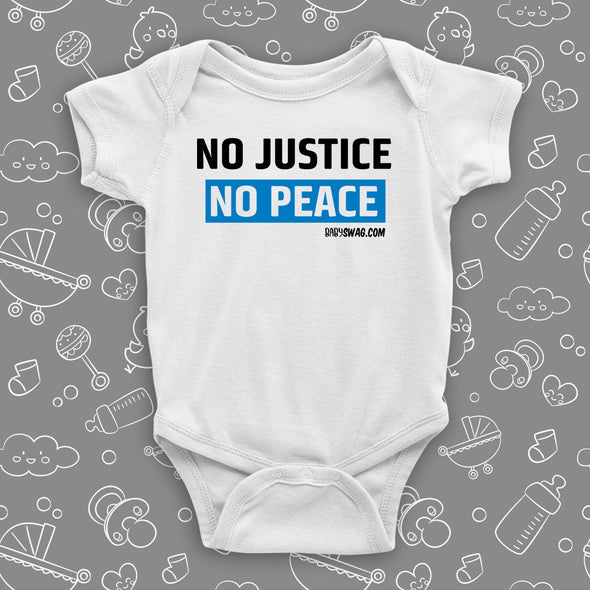 "White baby onesie with ""No justice, no peace"" print."