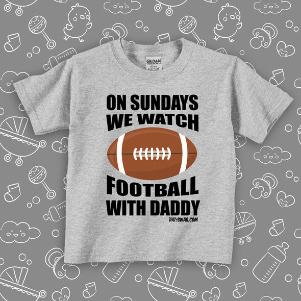 "The ""On Sunday We Watch Football With Daddy"" toddler boy shirt in grey."