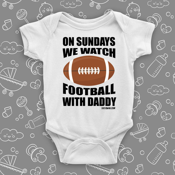 "Cute baby boy onesies with saying: ""On Sunday We Watch Foodball With Daddy"" in white."