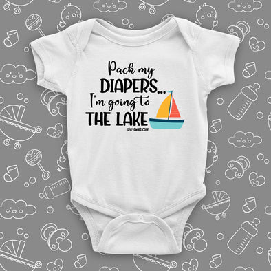 The ''Pack My Diapers, I'm Going To The Lake'' swag baby clothes in white.