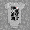 "Cute baby onesies with saying ""Rub Some Dirt On It"" in grey."