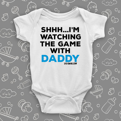"Cool toddler clothes with saying ""Shh...I'm Watching The Game With Dad"" in white."