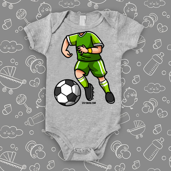 A graphic baby boy onesie with soccer bobblehead image, in color grey.