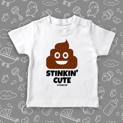 "Funny toddler graphic tee with saying ""Stinkin' Cute"" in white."