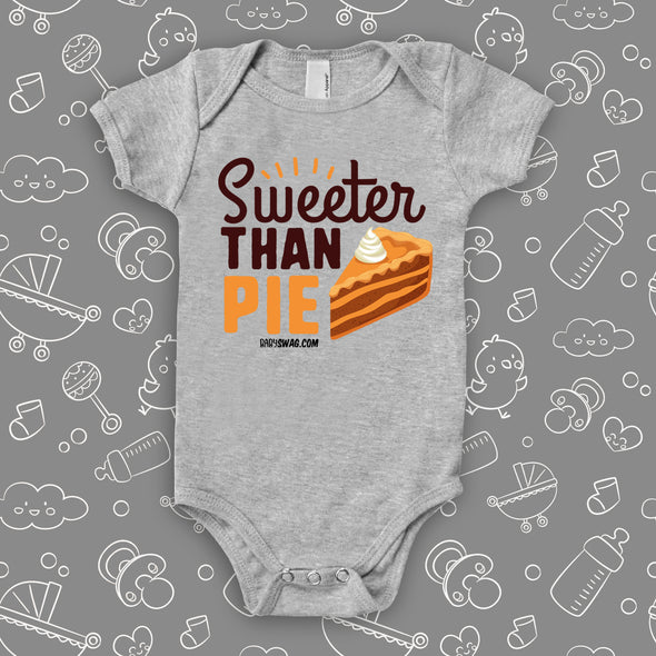 "Cute baby onesies with saying ""Sweeter Than Pie"" in grey."