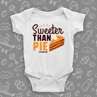 "Cute baby onesies with saying ""Sweeter Than Pie"" in white."