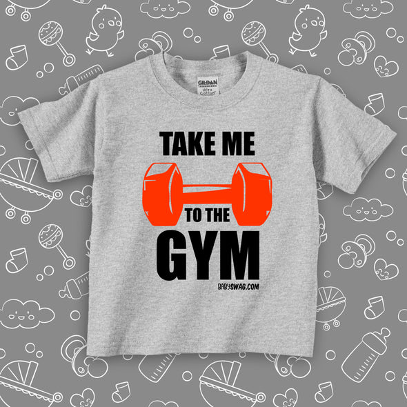 "Toddler graphic tee with saying ""Take Me To The Gym"" in white."
