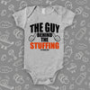"Funny baby onesies with saying ""The Guy Behind The Stuffing"" in grey."