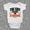 "Funny baby onesies with saying ""The Guy Behind The Stuffing"" in white."