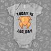 "Hilarious baby onesies with saying ""Today Is Leg Day"" and an image of roasted turkey in grey."