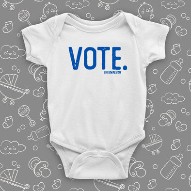 "White baby onesie with a ""Vote."" print."