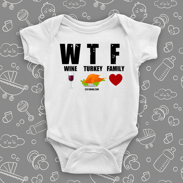 "Cute baby onesies with saying ""WTF Wine Turkey Family"" in white."