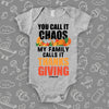 "Funny baby onesie with saying ""You Call Iy Chaos, My Family Calls It Thanksgiving"" in grey."