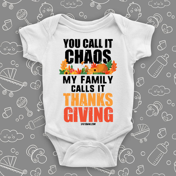 "Funny baby onesie with saying ""You Call Iy Chaos, My Family Calls It Thanksgiving"" in white."