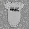 The Zoolander ''Really, Really Ridiculously Good Looking'' cool baby onesies in grey.
