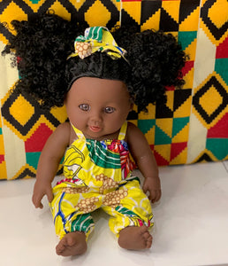 Doll (with a yellow jump suit)