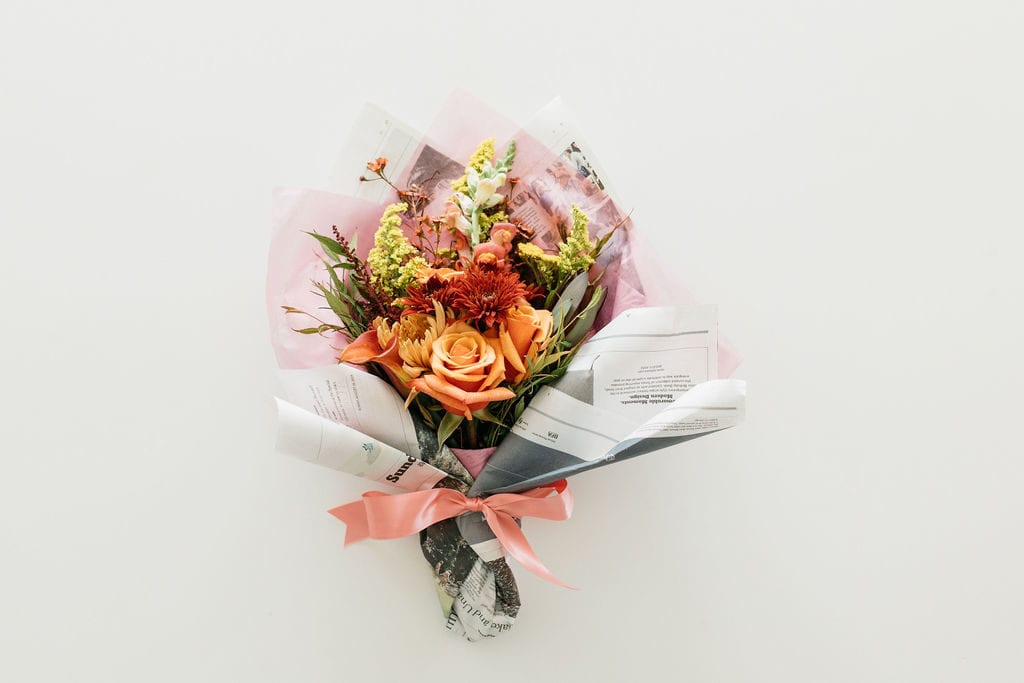 Small bouquet wrapped in newspaper