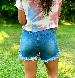 High waist raw edge button down denim shorts.